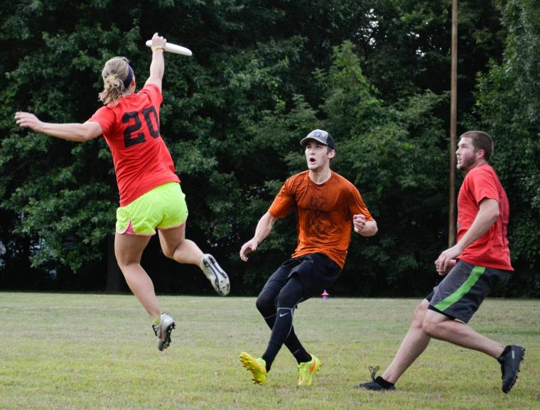 Ultimate Frisbee game.  Women jumping in air to catch frisbee.