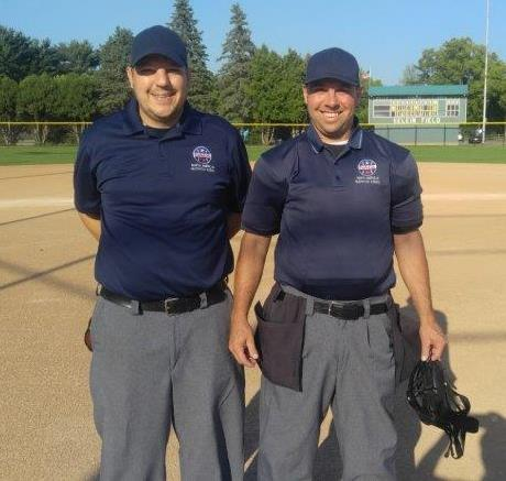 Picture of two umpires at ball field.