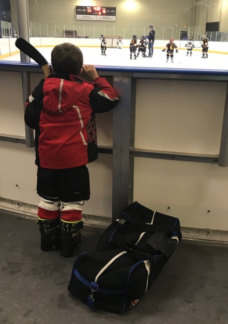 Boy Watching Youth Hockey