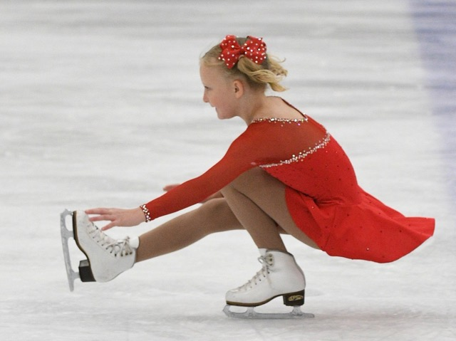 young figure skater twirling on ice