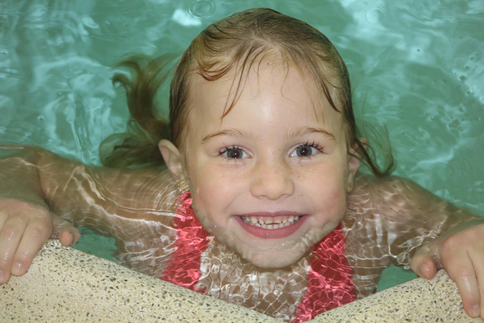 Young girl at indoor swimming lessons