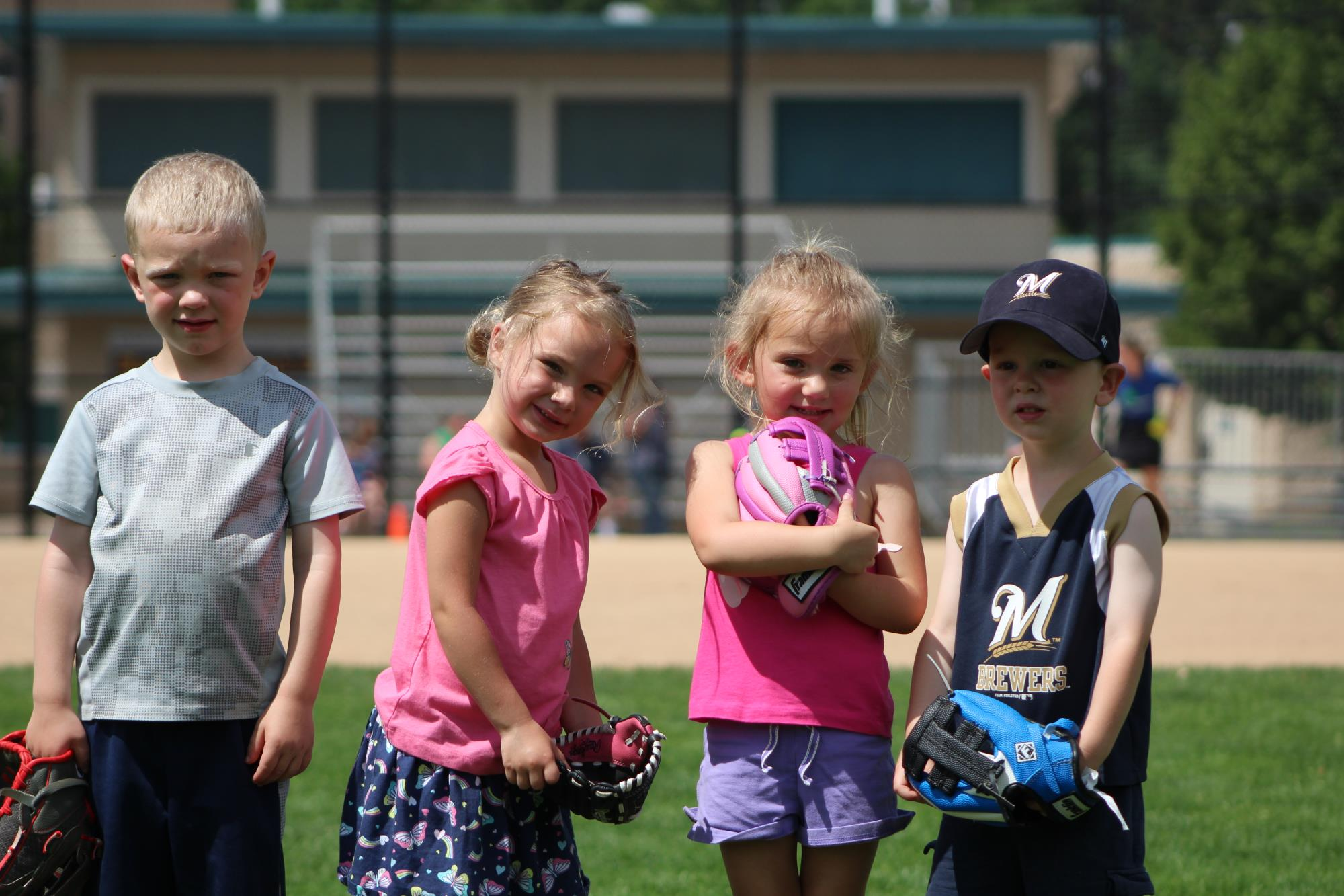 Tball group picture of small children at ballfield