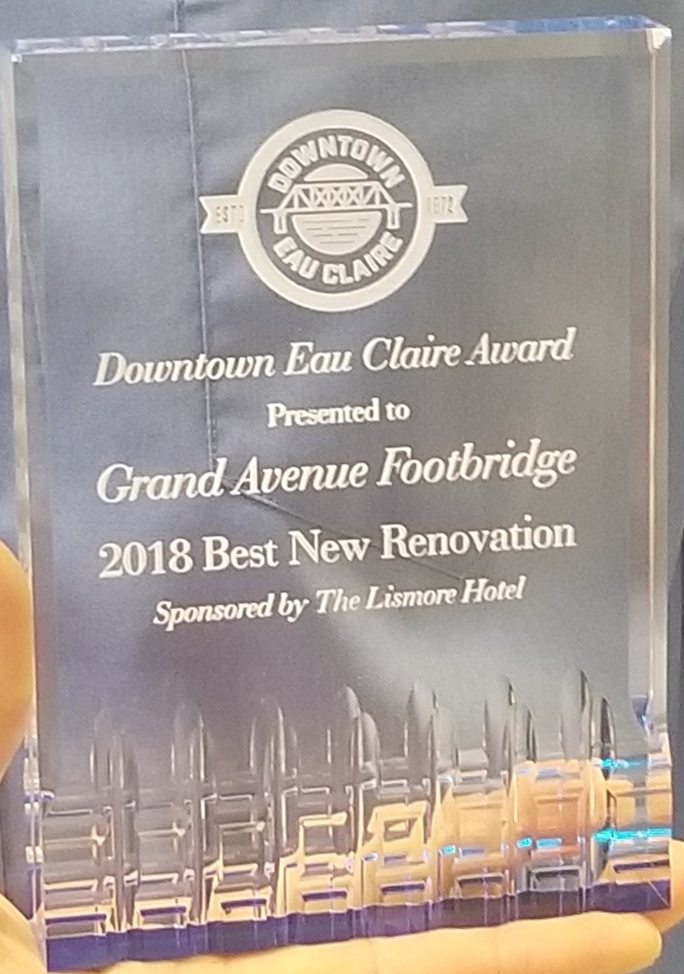 Downtown Eau Claire Downtown Eau Claire Award Presented to Grand Avenue Footbridge 2018 Best New Renovation Sponsored by The Lismore Hotel